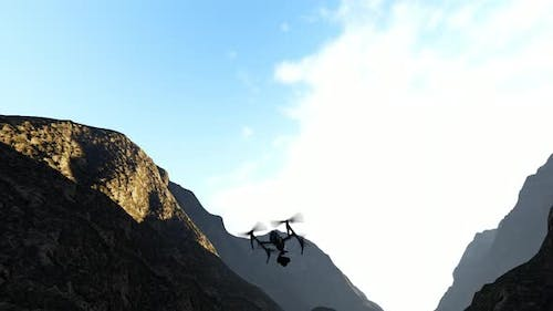Drone Flying Between the Mountains