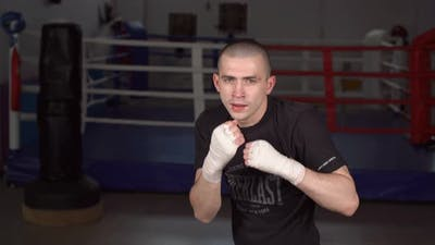 Man in Boxing Gloves in Boxing Training