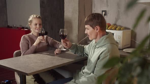 Nice Man Invited Beautiful Blonde To Visit He Tells Her Stories They Drink Wine Kitchen Table Clink