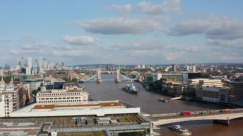 Sliding Reveal of Traffic on London Bridge Over River Thames