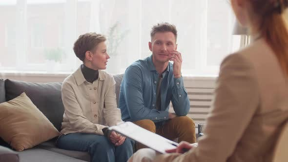 Thumbnail for Married Couple Communicating with Family Psychologist