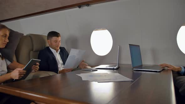 Thumbnail for Businesspeople Have Private Deal Discussion Inside of Business Jet