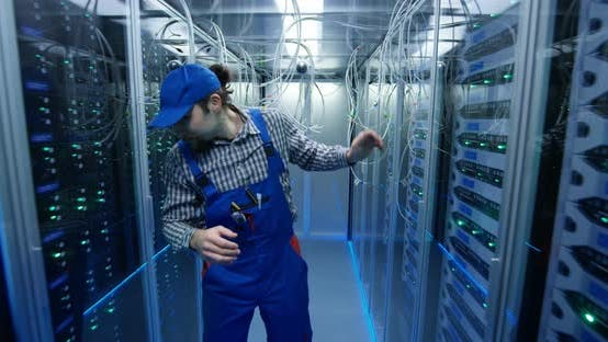 Thumbnail for Technician Passing Through Cables at a Data Center