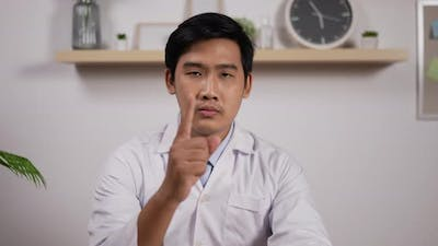 Male doctor pointing finger at camera