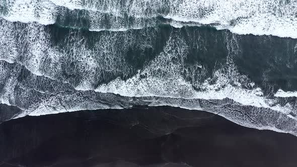 Thumbnail for Flying Over Ocean Waves Rushing to the Shore in Iceland