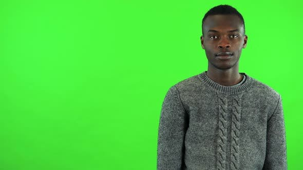 Thumbnail for A Young Black Man Extends His Arm To the Camera for a Handshake - Green Screen Studio