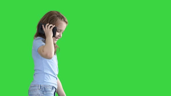 Thumbnail for Little Girl Talk Phone and Walking on a Green Screen, Chroma Key.