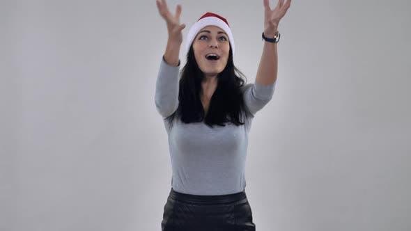 Thumbnail for Smiling Girl Santa Catches Present Present
