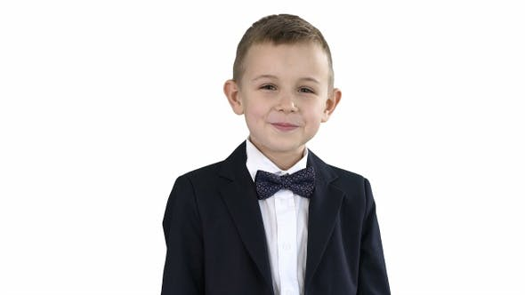 Thumbnail for Smiling little boy in formal clothes standing on white background.