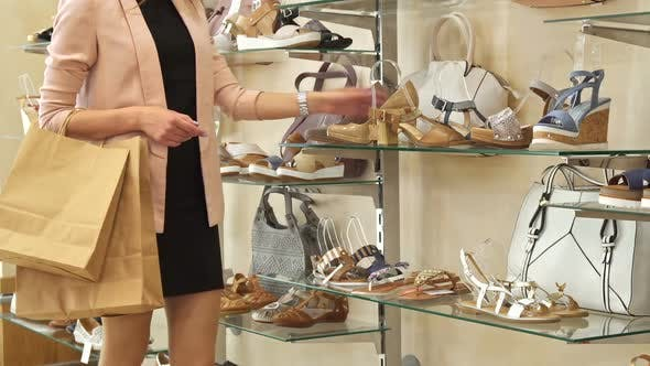 Thumbnail for Woman Stops Near the Beige Shoes at the Shop