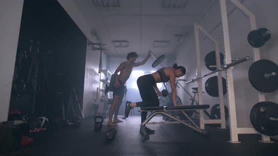 Thumbnail for Athletes In Gym With Dumbbells And Barbell