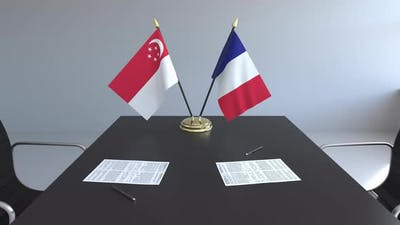 Flags of Singapore and France and Papers on the Table