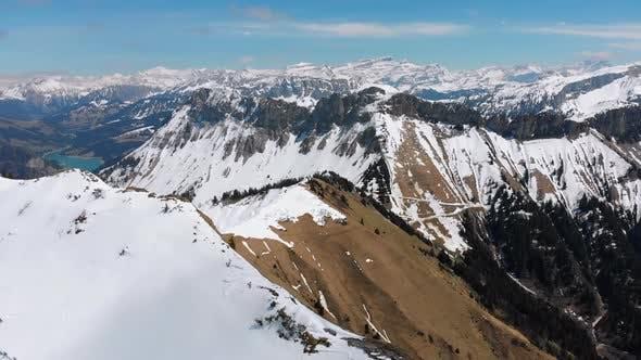 Thumbnail for Aerial Drone View on Snowy Peaks of Swiss Alps. Switzerland. Rochers-de-Naye Mountain Peak.