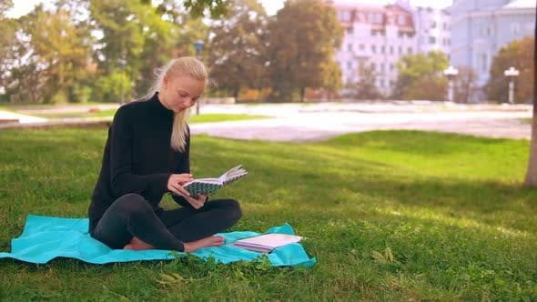 Thumbnail for Caucasian Girl with Studying Outdoors