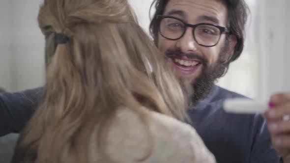 Thumbnail for Close-up Face of Young Caucasian Man with Black Beard Imitating Joy As His Wife Showing Affirmative