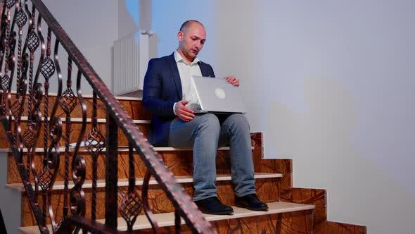 Thumbnail for Stressed Businessman Closing Laptop Sighing Sitting on Stairs