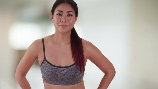 Thumbnail for Japanese woman runner looking at camera