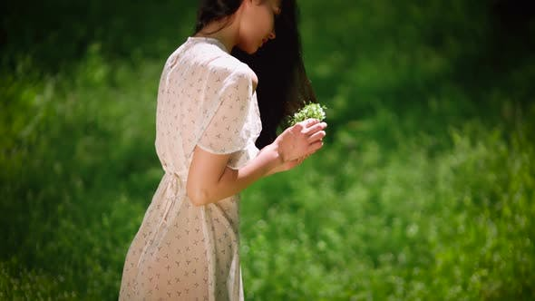 Woman Gathering Flowers