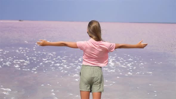Thumbnail for Girl on a Pink Salt Lake on a Sunny Summer Day