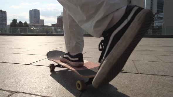 Thumbnail for Legs of Man Skateboarding Over Scenic Cityscape