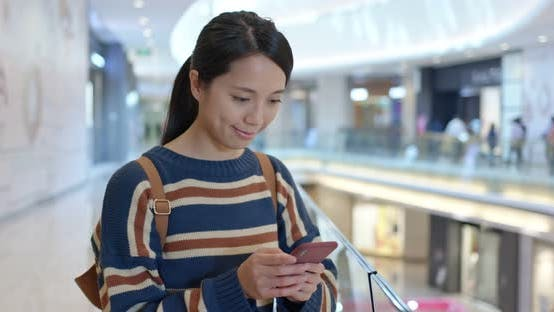 Thumbnail for Woman look at smart phone inside shopping mall