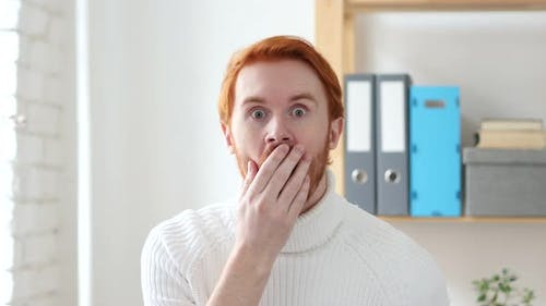 Shocked Man with Red Hairs at Work, Amazed by Surprise
