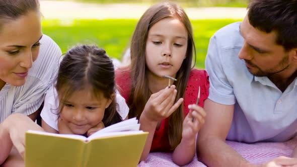 Thumbnail for Family Reading Book on Picnic in Summer Park
