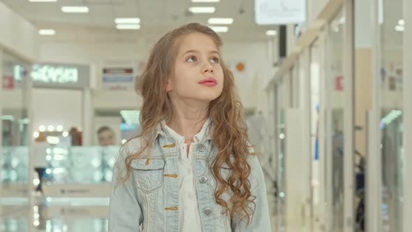 Thumbnail for Adorable Little Girl Smiling To the Camera at the Shopping Mall