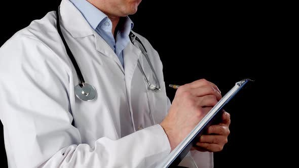 Cropped View of Doctor Writing on Clipboard