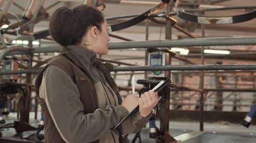 Woman Writing Down Meter Reading