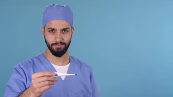 Thumbnail for Male Doctor Looking at Thermometer