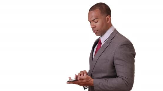 Thumbnail for An African American businessman crosses his arms and then looks at his smart phone on white backgrou