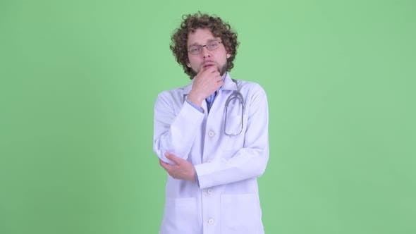 Thumbnail for Stressed Young Bearded Man Doctor Thinking and Looking Down