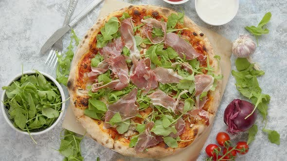 Thumbnail for Pizza with Prosciutto and Arugula, Served with Fresh Ingredients on Sides