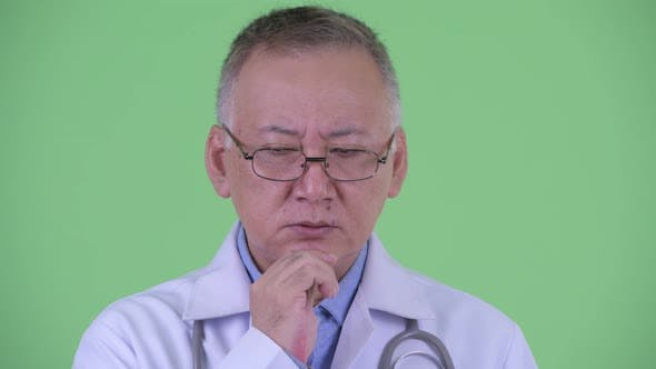 Thumbnail for Face of Stressed Mature Japanese Man Doctor Thinking
