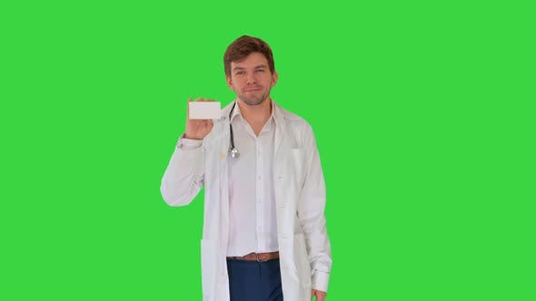 Thumbnail for Smiling Male Doctor Walking Advertising Pills Looking Camera Green Screen Chroma Key