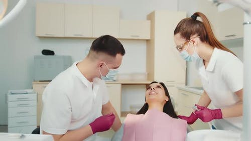 The Dentist Together with the Assistant Examine the Patient in the Dental Clinic