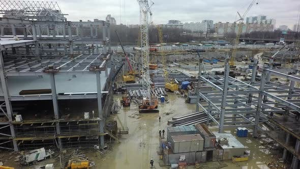 Thumbnail for Aerial View of Construction Site with Unfinished Steel Frame Buildings