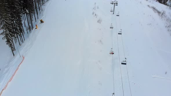 Thumbnail for Aerial View on Ski Slopes with Skiers and Ski Lifts on Ski Resort in Winter