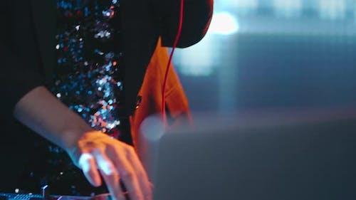 Female DJ in Evening Dress Playing Music