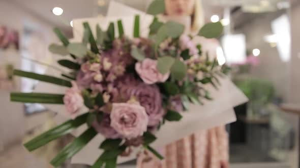 Girl Florist Rotates And Shows Bouquet To The Camera. Slow Motion