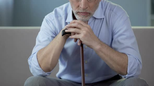 Thumbnail for Aged Man Sitting on Sofa and Coughing, Complications of Pneumonia, Health