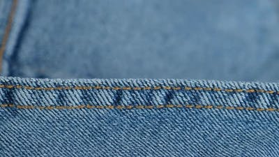blue denim jeans stitching  macro.  stitching on jeans
