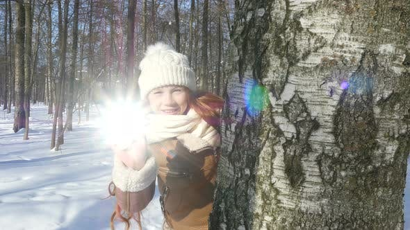 Happy Teenager Girl Playing In Winter Park, Kid Lets The Sunlight Spot