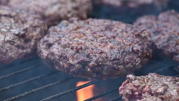 Thumbnail for Cooking beef burgers for hamburgers on flame grill