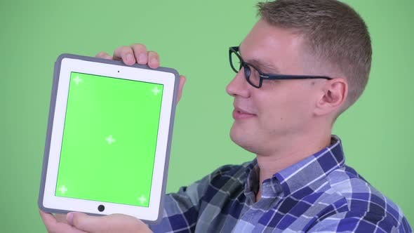 Thumbnail for Closeup Happy Young Hipster Man Showing Digital Tablet
