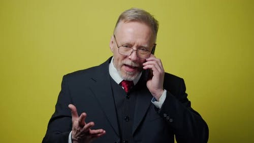 Nervous middle aged businessman with a cellphone