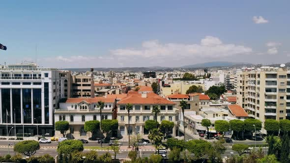 Thumbnail for Aerial of Limassol, Camera Rises Up Above Embankment Overlooking Buildings of City