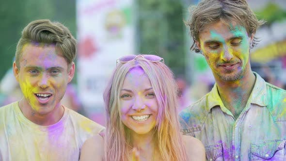 Thumbnail for Joyful Young People Smiling to Camera, Clapping Hands Covered in Color Powder