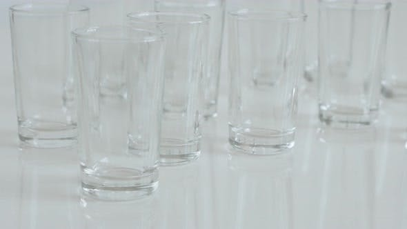 Many transparent  spirits or liquor drink glasses 4K 2160p 30fps UltraHD footage - Close-up of shot